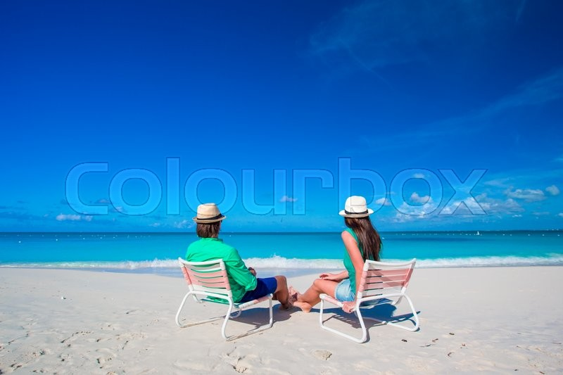 Stock image of 'Young happy couple have fun during beach vacation'