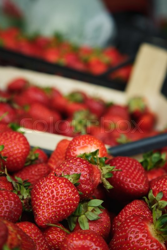 Stock image of 'ripe juicy strawberries sitting in the box on the market'