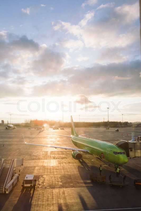 Editorial image of 'SAINT PETERSBURG, RUSSIA - APRIL 25, 2016: the S7 airlines plane on the runway of the airport in the setting sun'