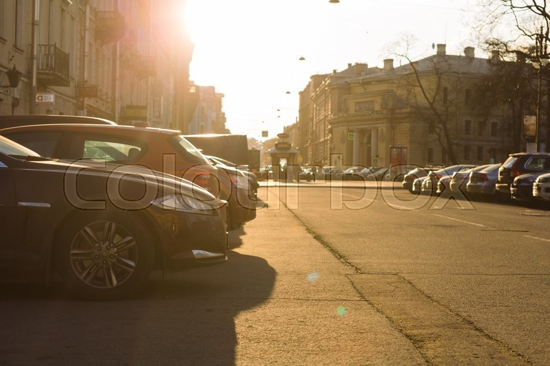Editorial image of 'SAINT PETERSBURG, RUSSIA - APRIL 25, 2016: car Parking in the city center of Saint-Petersburg in the spring rays of the setting sun'