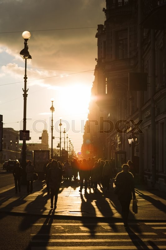 Editorial image of 'SAINT PETERSBURG, RUSSIA - APRIL 25, 2016: people walking along Nevsky Prospekt in St. Petersburg in the spring rays of the setting sun'