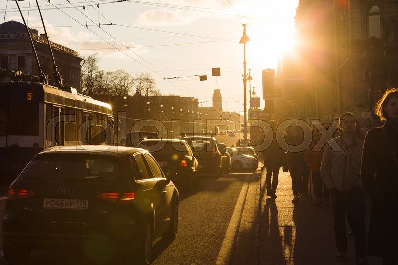 Editorial image of 'SAINT PETERSBURG, RUSSIA - APRIL 25, 2016: the cars and the trolley stand at the traffic lights in the centre of St. Petersburg in the spring rays of the setting sun'