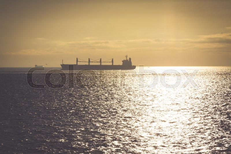 Stock image of 'Transportation, containers cargo ship out of the harbor'