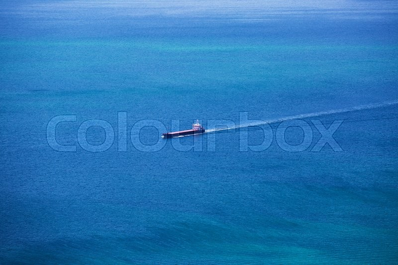 Stock image of 'Cargo Ship Sailing in the Atlantic Ocean, sunny day'