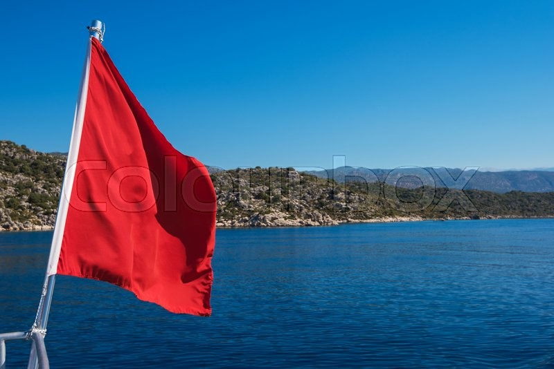Stock image of 'Red Flag from yacht, on sea background'