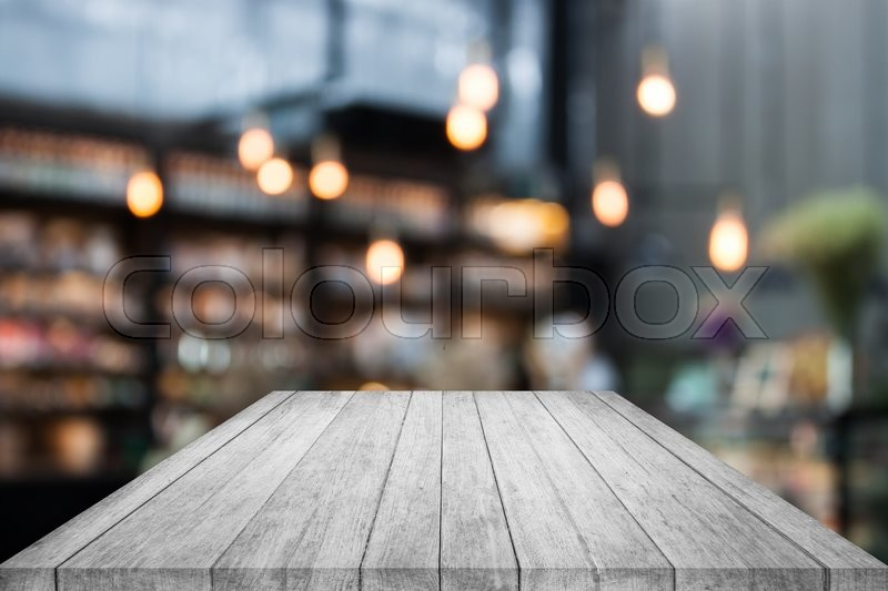 Stock image of 'Black and white table top wood with coffee shop blurred background with bokeh'
