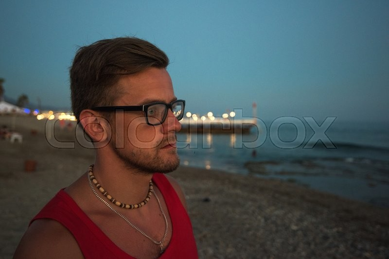 Stock image of 'Young man at the evening sea, on the beach at Alania, Turkey'