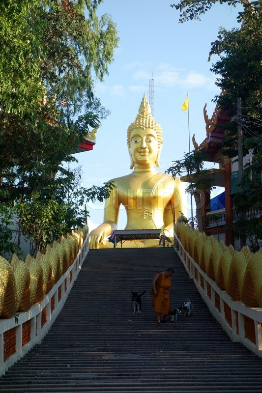 Stock image of 'Big Buddha.Monk and the Dog. Pattaya, Thailand.February 21, 2015'