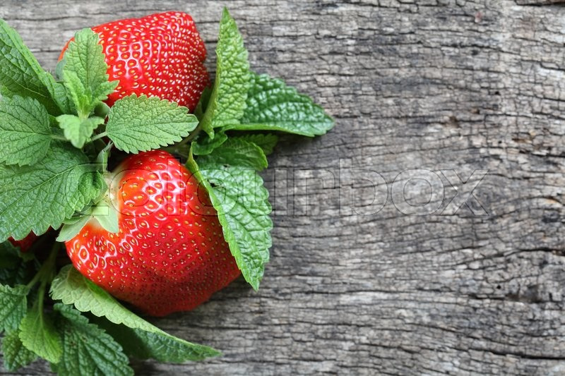 Stock image of 'Fresh strawberries on wooden background whith mint leaf'