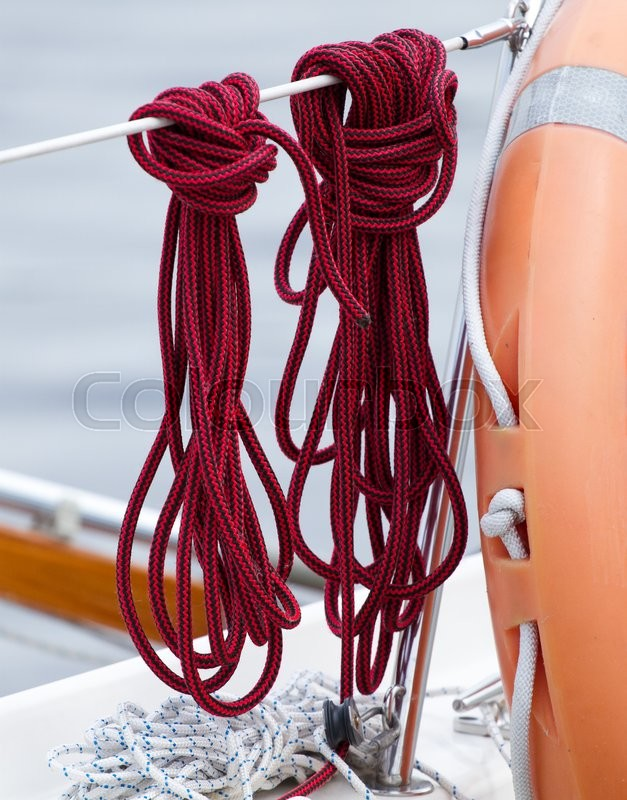 Stock image of 'Nautical boat details of a rope and lifebuoy'