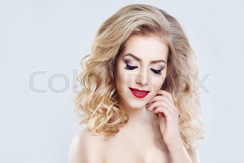 Stock image of 'Blonde Hair Woman. Long Curly Hairstyle and Makeup'