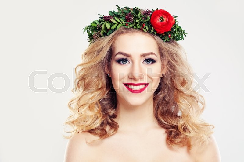 Stock image of 'Woman with Clear Skin, Curly Blond Hair and Flowers Wreath'