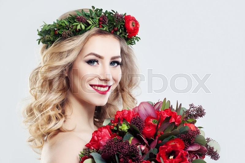 Stock image of 'Beautiful Woman Fashion Model with Flowers Bouquet'