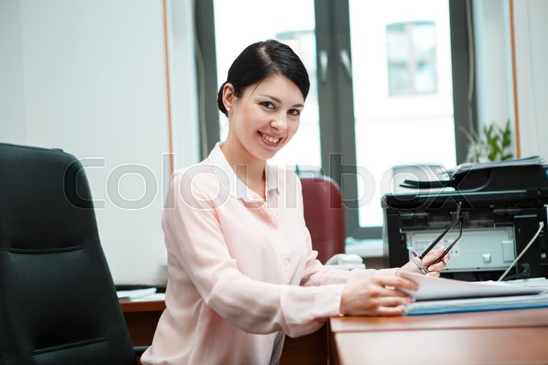 Stock image of 'Modern business woman in the office'