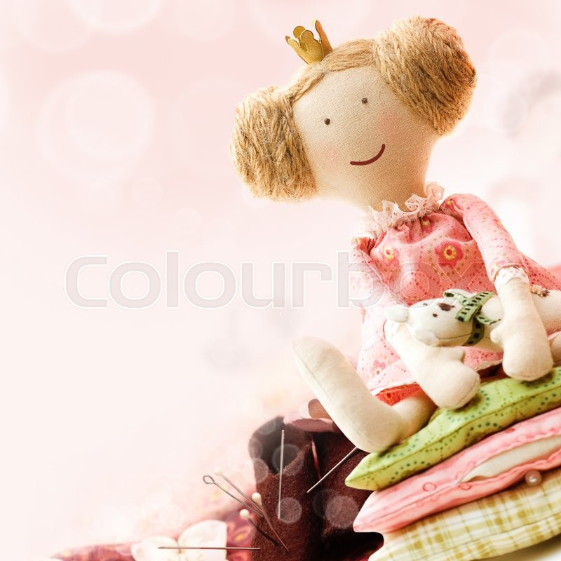 Stock image of 'Art Sewing Accessory Background with Doll'