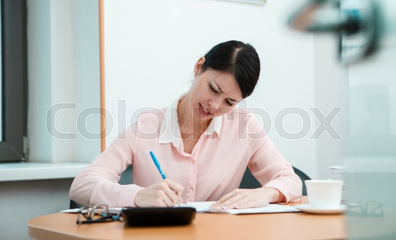 Stock image of 'Woman in office with crumpled paper. Office life concept.'