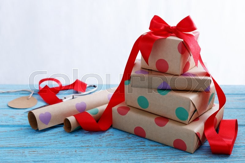 Stock image of 'Presents for birthday with wrapping paper and red ribbon'