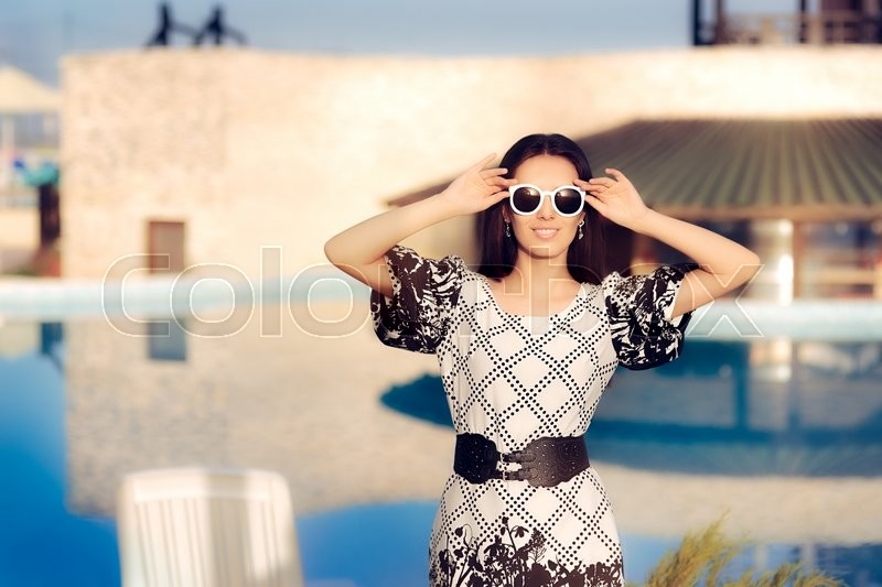 Stock image of 'Happy Summer Woman With Sunglasses by the Pool'