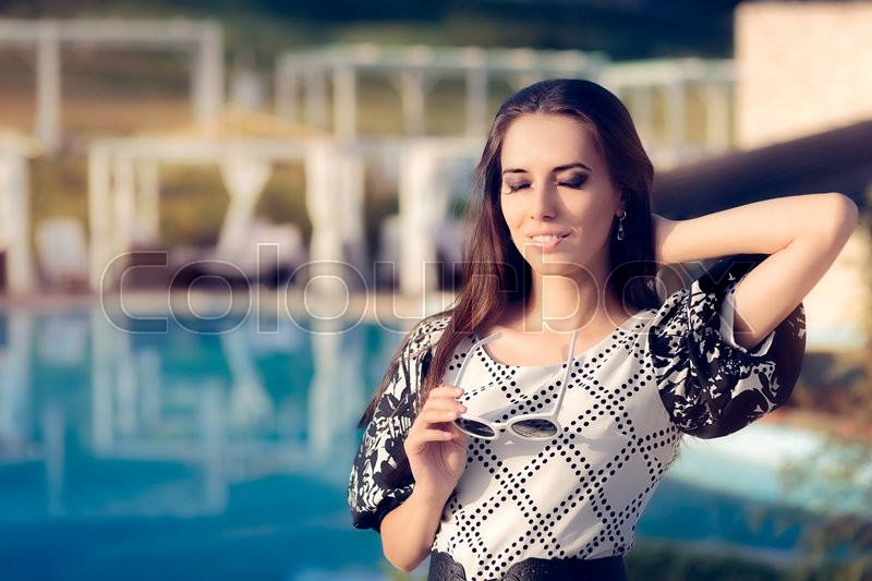 Stock image of 'Happy Woman by the Pool Enjoying Summer Holiday'