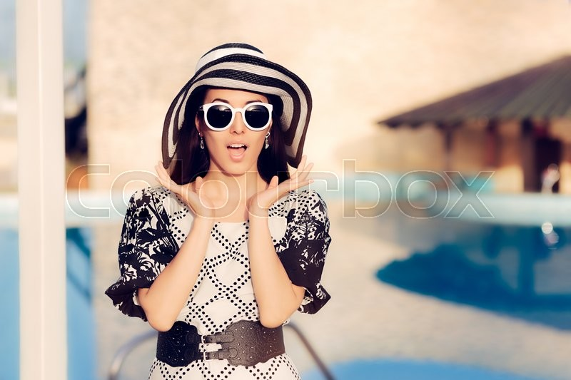 Stock image of 'Surprised  Woman With Sunglasses and Sun Hat by the Pool'