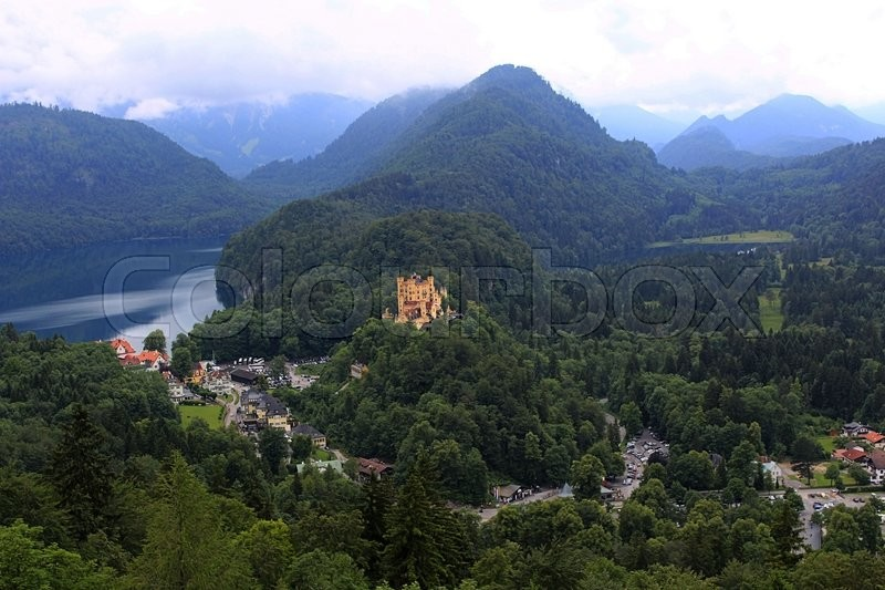 Stock image of 'Looking down on Bavarian Alpine valley, featuring Hohenschwangau Castle and Lake Alpsee. Neuschwanstein, Germany, Europe.'