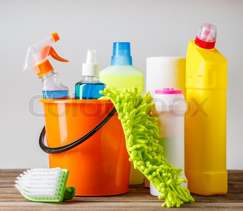 Stock image of 'Bucket with cleaning items on light background'
