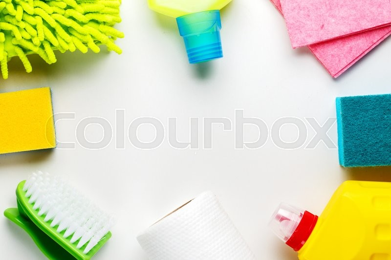 Stock image of 'House cleaning products on white table. Top view.'