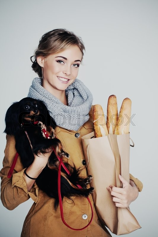 Stock image of 'Young Woman Fashion Model. Girl, Dog and Baguette '