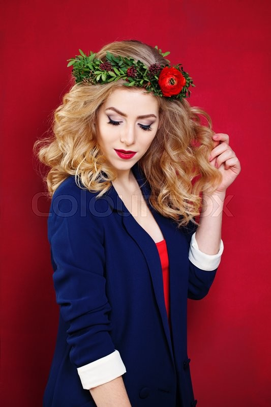 Stock image of 'Blonde Model on Red Background'