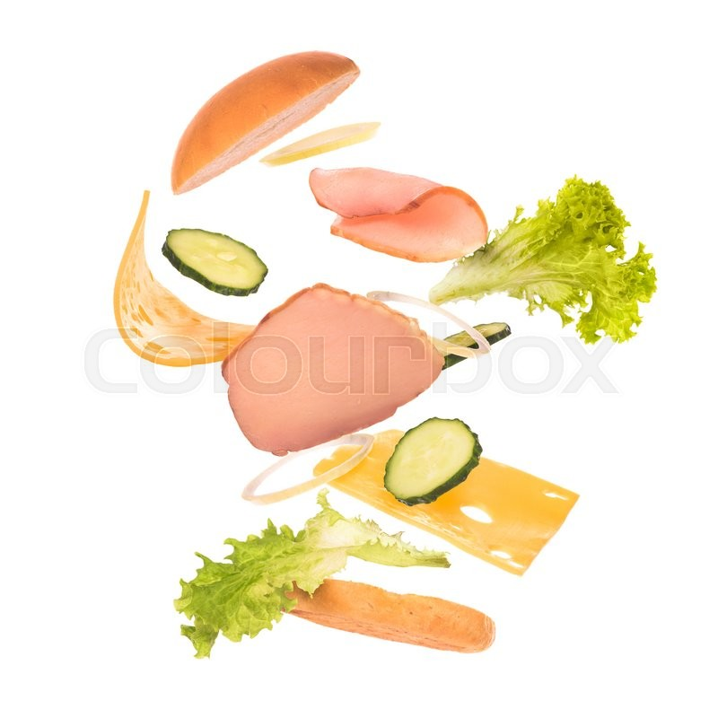 Stock image of 'burger components in flight on white background '