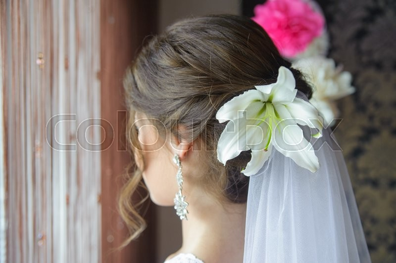 Stock image of 'beautiful hairstyle bride with white flower'