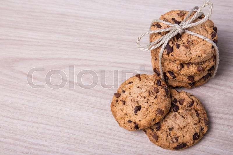 Stock image of 'top view of freshly baked chocolate chip cookies on wooden table background'