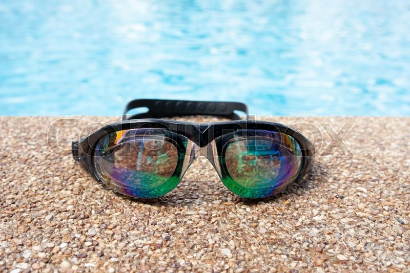 Glasses for swimming on a cement floor ... | Stock image ...
