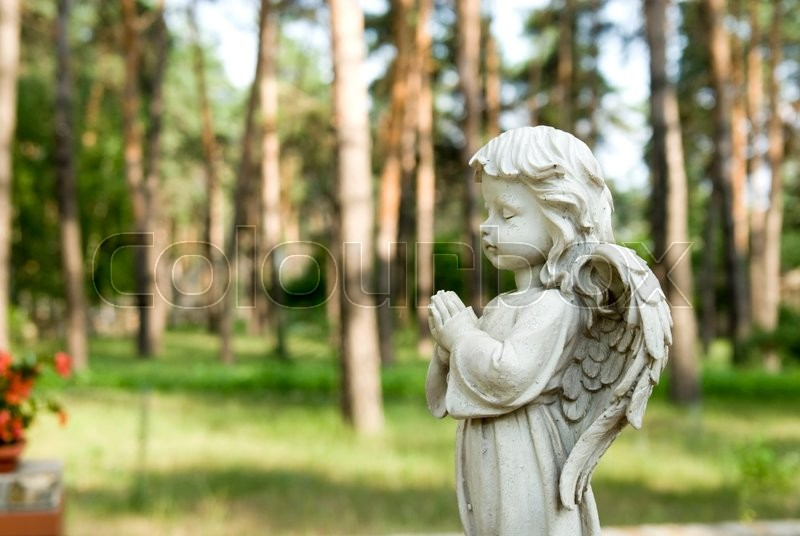 Stock image of 'fragment shapes little angel in a city park'