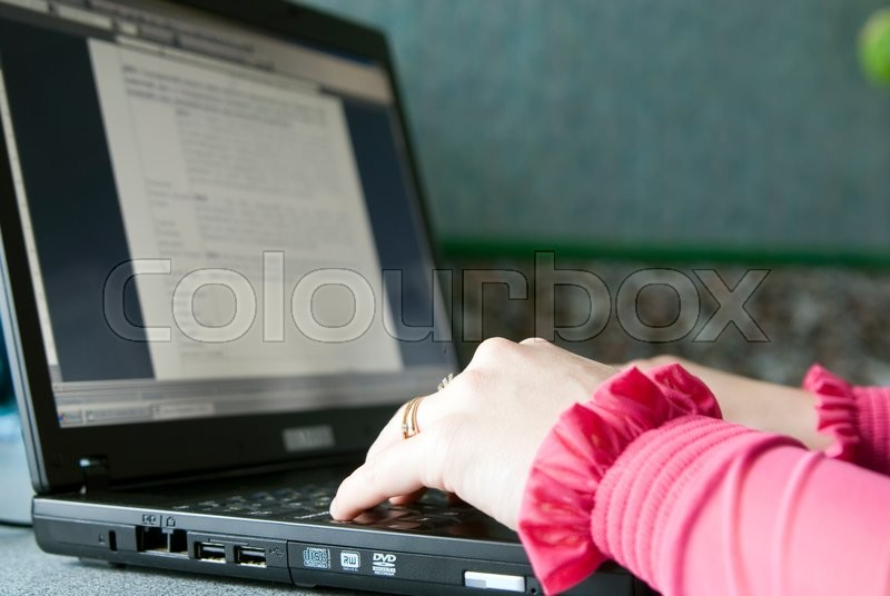 Stock image of 'Image of female hands on the keys typing documents'