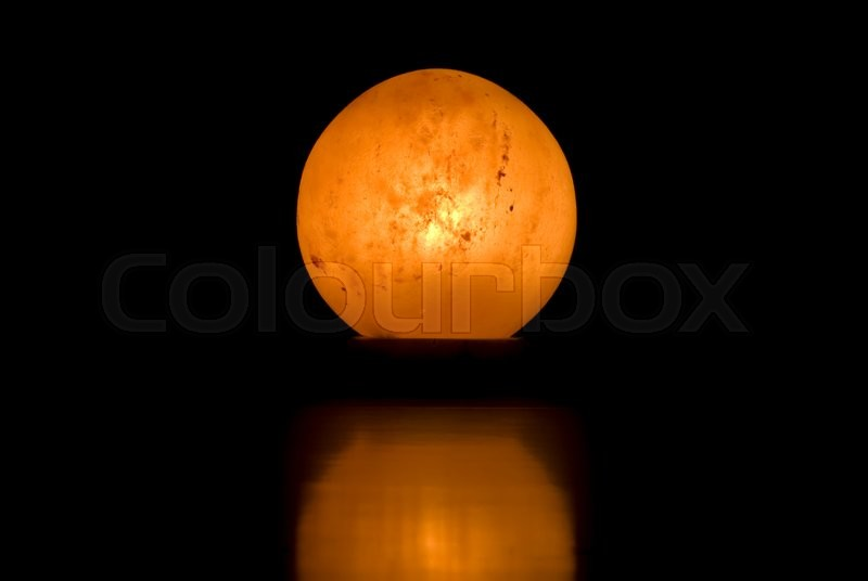 Stock image of 'a close up of a salt lamp shot on black'