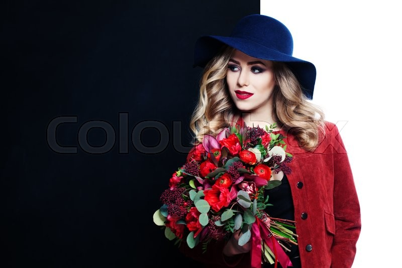 Stock image of 'Pretty Model Holding Flowers Bouquet on Black and White Background'