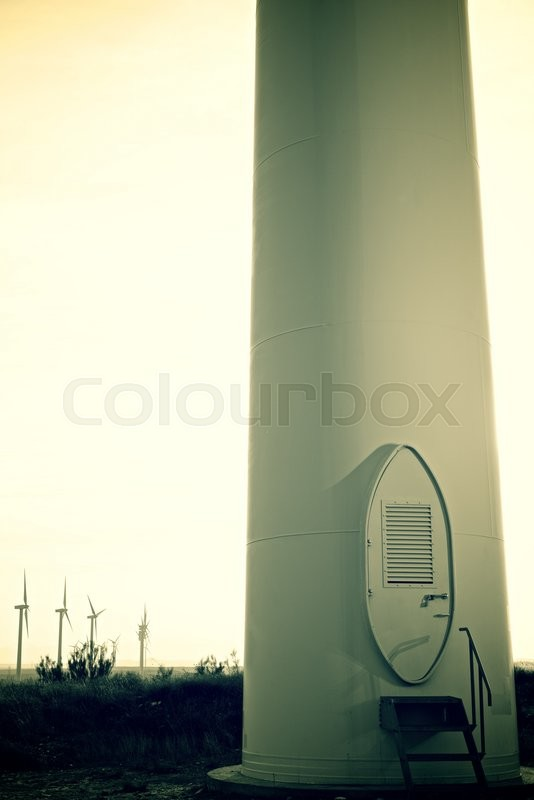 Stock image of 'Windmills for electric power production at sunset, Pozuelo de Aragon, Zaragoza, Aragon, Spain'