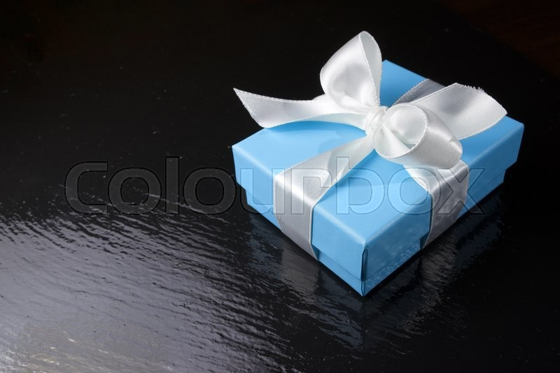 Stock image of 'Luxury box tied with a white ribbon.'