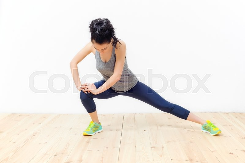 Stock image of 'young beautiful girl engaged in fitness at home'