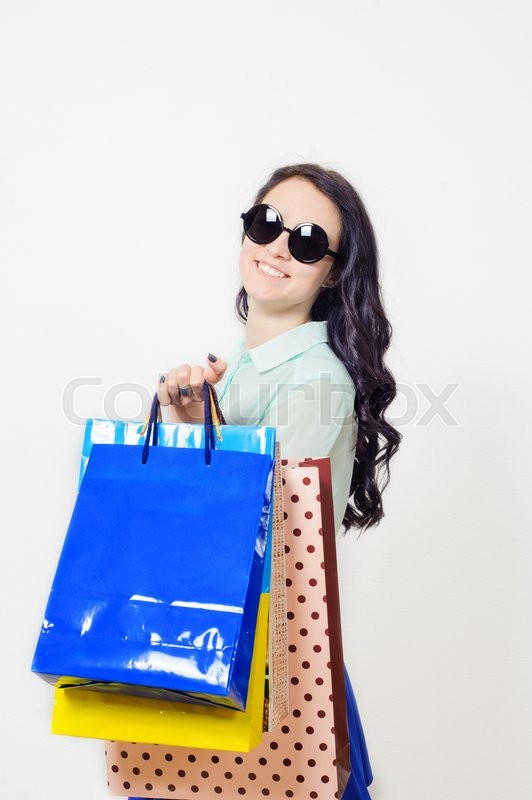 Stock image of 'young beautiful smiling girl in a store shopping'