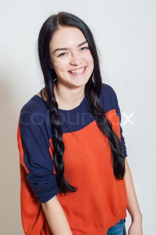 Stock image of 'portrait of a beautiful young girl on a light background'