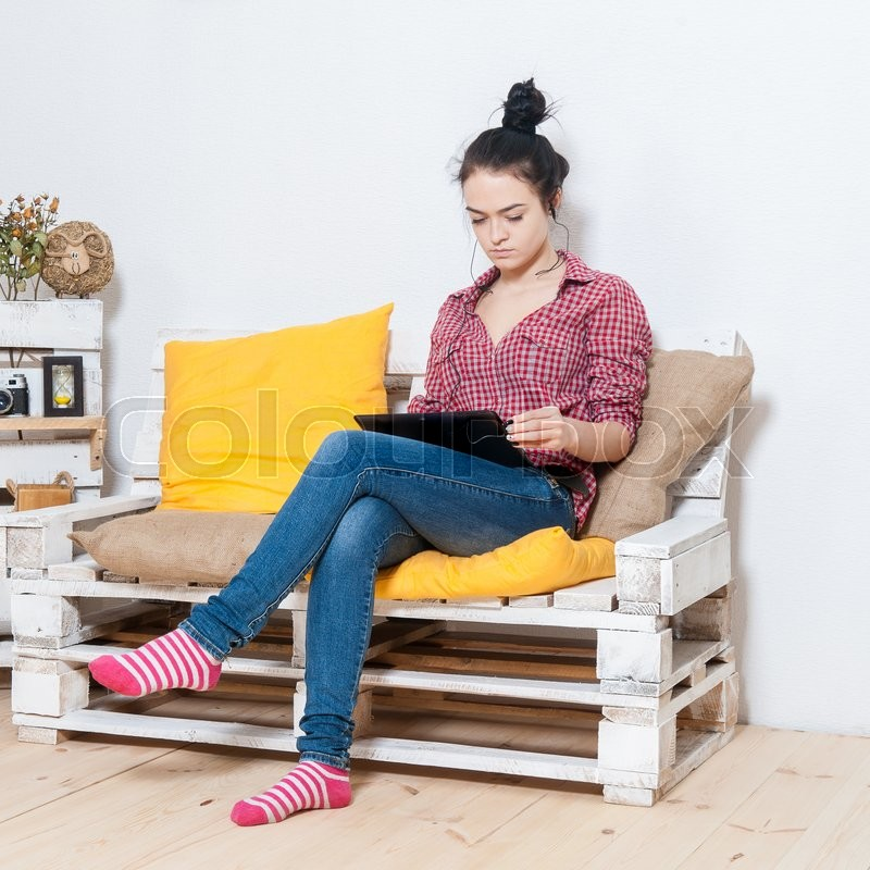 Stock image of 'Portrait of a girl with the tablet'