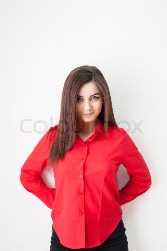 Stock image of 'Portrait of a young girl on a white background in a red shirt'