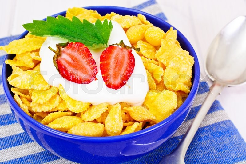 Stock image of 'Cornflakes with Strawberry. Healthy Breakfast Studio Photo'
