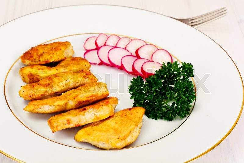 Stock image of 'Grilled Chicken Fillet with Radish and Parsley Studio Photo'