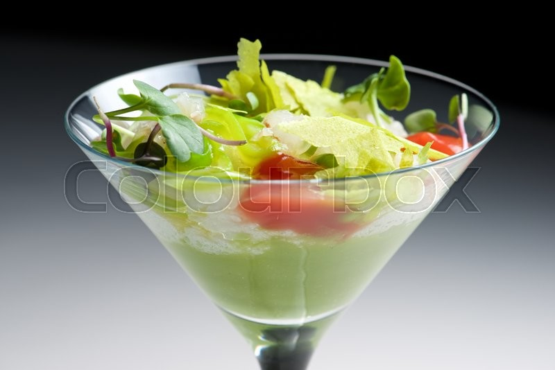 Stock image of 'Tomato and green vegetables salad served in crystal glass.'