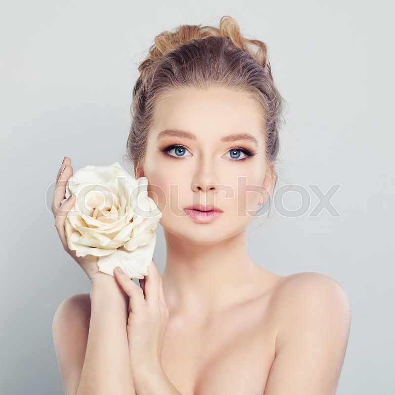 Stock image of 'Young Woman with White Rose. Spa Model'