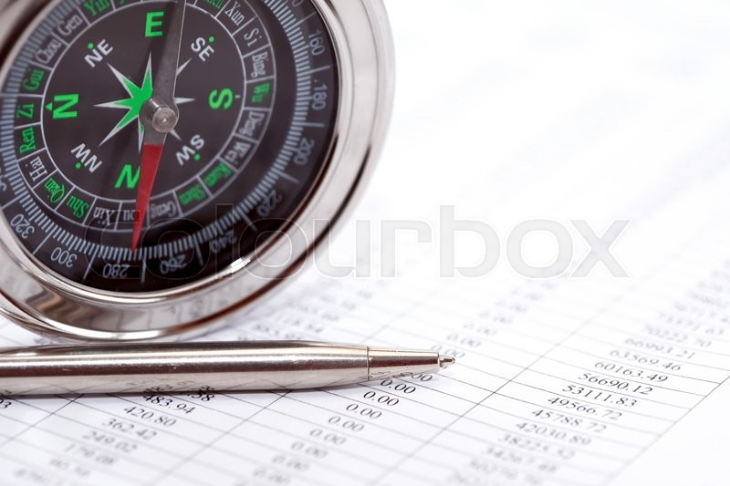 Stock image of 'Business direction. Closeup of compass near pen on paper with digits'
