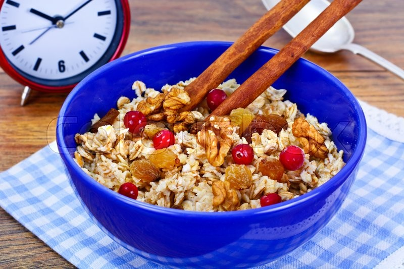 Stock image of 'Oatmeal with Raisins, Walnuts and Cranberry Studio Photo'